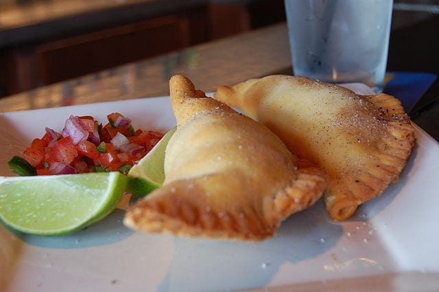 Empanadas filled with beef, onions, peppers, olives and garlic