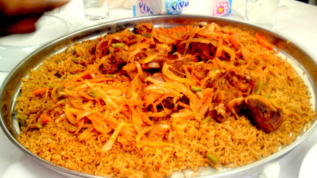Jollof rice is a one-pot rice dish with tomatoes, vegetables & spices